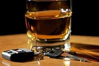 Glass of alcohol on a table - Bakersfield felony DUI attorney